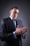 Frightening man rubs his hands Stock Photos