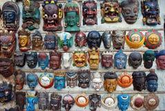 Scary dragon masks on sale in Hanoi Vietnam. Frightening masks hanging on wall in Hanoi Vietnam stock image
