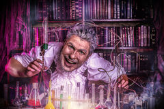 Frightening scientist. Crazy old man medieval scientist working in his laboratory. Alchemist. Halloween Royalty Free Stock Photography