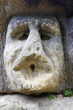 Frightening Stone Head Stock Photo