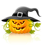Frightful halloween pumpkin vegetable in black hat Royalty Free Stock Photo