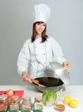 Frigideira chinesa do divertimento que cozinha a lição Imagens de Stock