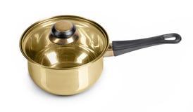 Frigideira dourada imagem de stock