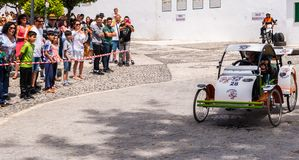 FRIGILIANA, SPAIN - MAY 13, 2018 `Autos Locos` - traditional fun involving the ride of cardboard cars in small spanish town. Self-made vehicles, creative and stock images