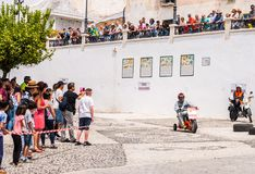 FRIGILIANA, SPAIN - MAY 13, 2018 `Autos Locos` - traditional fun involving the ride of cardboard cars in small spanish town. Self-made vehicles, creative and stock photo