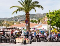 FRIGILIANA, SPAIN - MAY 13, 2018 `Autos Locos` - traditional fun involving the ride of cardboard cars in small spanish town. Self-made vehicles, creative and royalty free stock photos