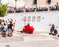 FRIGILIANA, SPAIN - MAY 13, 2018 `Autos Locos` - traditional fun involving the ride of cardboard cars in small spanish town. Self-made vehicles, creative and royalty free stock photography