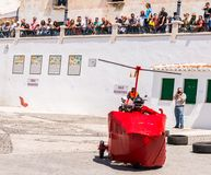 FRIGILIANA, SPAIN - MAY 13, 2018 `Autos Locos` - traditional fun involving the ride of cardboard cars in small spanish town. Self-made vehicles, creative and royalty free stock image