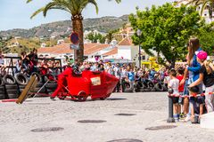 FRIGILIANA, SPAIN - MAY 13, 2018 `Autos Locos` - traditional fun involving the ride of cardboard cars in small spanish town. Self-made vehicles, creative and stock photos