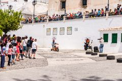 FRIGILIANA, SPAIN - MAY 13, 2018 `Autos Locos` - traditional fun involving the ride of cardboard cars in small spanish town. Self-made vehicles, creative and stock photography