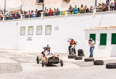 FRIGILIANA, SPAIN - MAY 13, 2018 `Autos Locos` - traditional fun involving the ride of cardboard cars in small spanish town. Self-made vehicles, creative and royalty free stock images