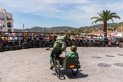 FRIGILIANA, SPAIN - MAY 13, 2018 `Autos Locos` - traditional fun involving the ride of cardboard cars in small spanish town. Self-made vehicles, creative and royalty free stock photo