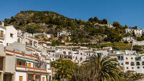 Frigiliana. Views of the houses white of the village of Frigiliana with the mountain to the bottom Stock Photography