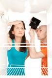 Frigorifero vuoto del raccoglitore vuoto fotografie stock libere da diritti