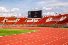 friidrottbakgrundsräkningen lines fläckred som kör specialsportstadionspåret Starta gränden 1, royaltyfria bilder