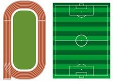 Friidrottspår med fotbollfältet Arkivfoto