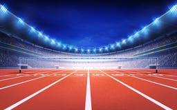 Friidrottstadion med sikt för fullföljande för loppspår Royaltyfri Foto