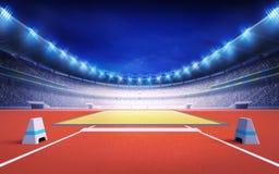 Friidrottstadion med stolpen för långt och trefaldigt hopp Arkivfoto