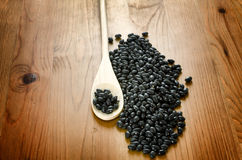 Black beans on wooden background Royalty Free Stock Images