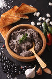 Frijoles refritos with ingredients close-up. Vertical Royalty Free Stock Image