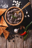 Frijoles refritos with ingredients close-up. vertical top view Stock Photos