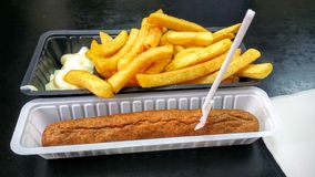 Frikandel. With french fries Stock Image