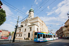 Frilly advertising tram rides in front of the church of old city Royalty Free Stock Images