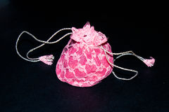 Frilly pink pouch. Pink pouch with frills and drawstring Royalty Free Stock Images