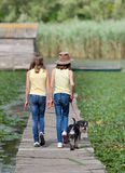 Frineds with dog on river Stock Image