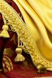 Fringe on the background of  fabrics Royalty Free Stock Images