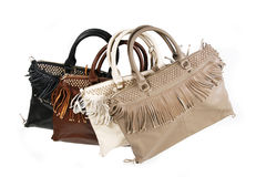 Fringe handbags. Isolated on white stock photography