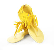 Fringe yellow flat shoes. On white background Royalty Free Stock Photography