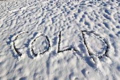 Frio escrito na neve Fotografia de Stock