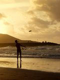 Frisbee. A man throws a frisbee in the ocean on an beach at sunset Stock Photo
