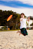 Frisbee. Young boy playing frisbee on the beach Stock Photos