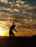 Frisbee in Sunset. Guy playing Frisbee in Sunset, jumping and catching, silhoutte royalty free stock photo