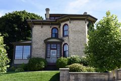 Frisby House. This is a Summer picture of the Leander F. Frisby House located in West Bend, Wisconsin in Washington County.  This two story house with a large Royalty Free Stock Photo