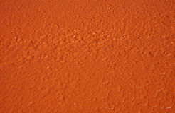 Frisch orange gemalter Asphalt Stockbild