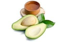 Frische Avocado mit Avocadoöl Lizenzfreies Stockbild
