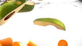 Frische Avocado und Karotte im Wasser stock video footage