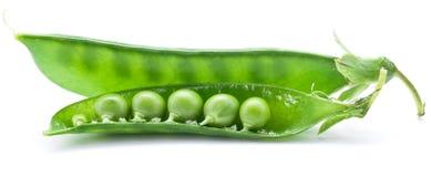 Frische Erbsen werden innerhalb einer Hülse enthalten Lizenzfreies Stockfoto