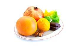 Frische Früchte und Bonbons Lizenzfreies Stockfoto