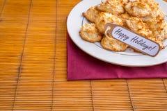 Frische gebackene Kokosmakronen mit den Jahreszeiten, die Tag grüßen lizenzfreie stockfotos