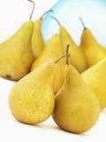Frische gelbe Birnen-Früchte Stockfotos