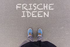 Free Frische Ideen, German Text For Fresh Ideas Text On Asphalt Ground, Feet And Shoes On Floor Royalty Free Stock Image - 88566136