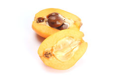 Frische Loquatfrucht (Eriobotrya japonica) und ein Schnitt einer Lizenzfreie Stockfotografie