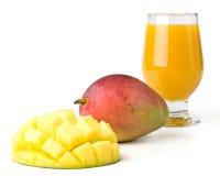 Frische Mangofrucht und Glas Mangofruchtsaft Lizenzfreie Stockfotografie