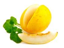 Frische Melone mit grünem Blatt Lizenzfreie Stockfotografie