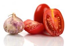 Frische Rom-Tomaten mit Lizenzfreie Stockfotografie