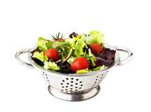Frische Salatblätter und Kirschtomaten Stockbild